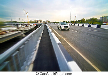 car going on the new bridge in a city