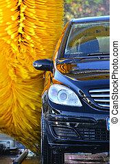 Car going through an automated car wash machine - Car going...