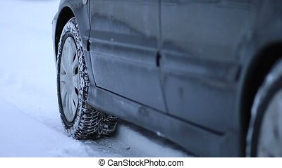 Car got stuck in the snow. Front wheel in winter tyre...