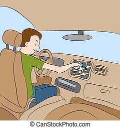 Car GPS Navigation - An image of a man using his car GPS...