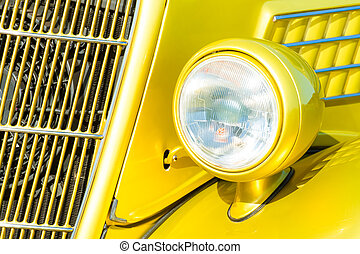 car grille and headlight - bright yellow vintage vehicle...