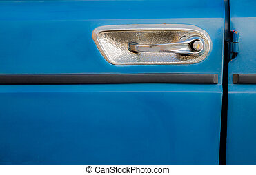 car handle on blue background, horizontal composition