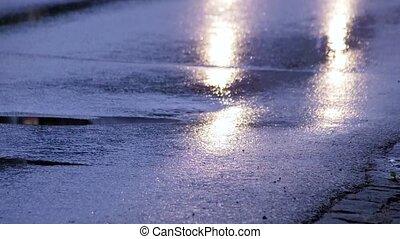 car head light on wet street