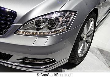 Headlight of a silver luxurious car
