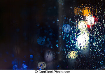 Car Headlights and Streetlights in Rain - Car headlamps and...