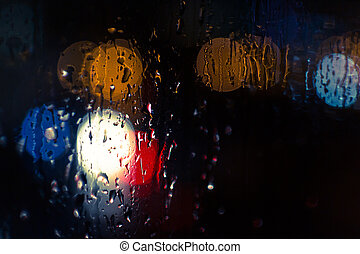 Car Headlights and Streetlights in Rain