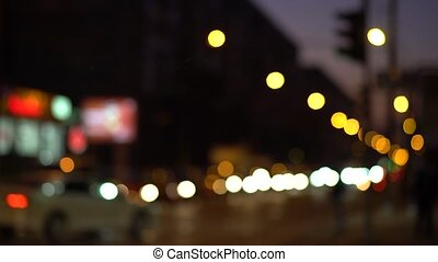 Car headlights and tail lights out of focus - Bright...