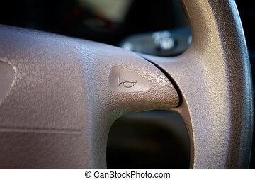 Car Horn - A car horn on a steering wheel