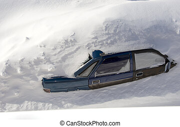 Car in a snowdrift to the very roof, top view. The passenger car was covered with snow. There is a lot of snow outside.