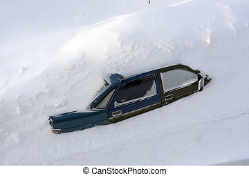 Car in a snowdrift, top view. The passenger car was covered with snow. There is a lot of snow outside.