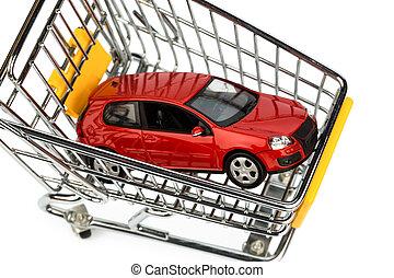 car in cart - a car in the shopping cart as a symbol of car...