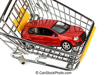 car in cart - a car in the shopping cart as a symbol of car...