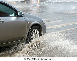 car in floods - Flooding in the city with car and driving ...