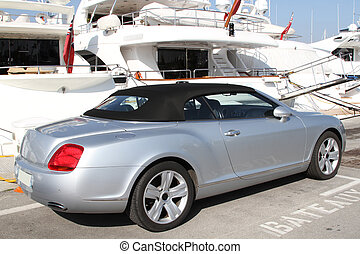 Car in front of yacht