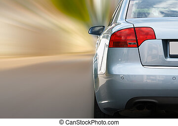 Car in motion  - silver sports car on a colorful background