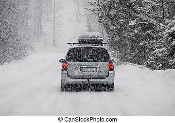 Car in snow - Car driving during winter snow taken through a...
