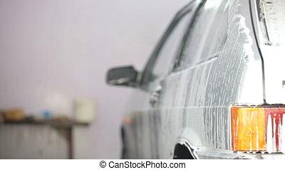 car in soap foam