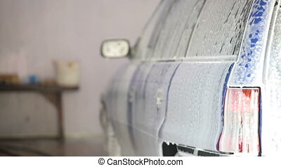 car in suds at carwash