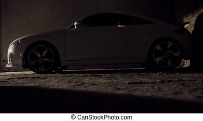 Car in the parking in dark garage - White expensive car in...