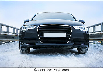 car in winter on road