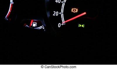Car instrument panel illuminated at night