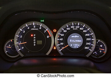 Car instrument panel. Illuminated in the night.