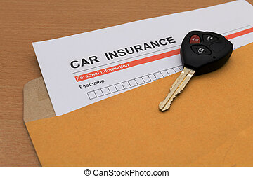 Car Insurance application form and key on brown envelope