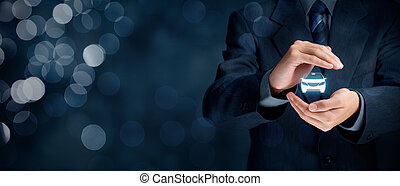 Car (automobile) insurance and collision damage waiver concepts. Businessman with protective gesture and icon of car. Wide banner composition with bokeh in background.