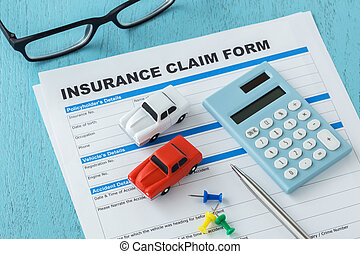 Car insurance claim form with calculator and pen