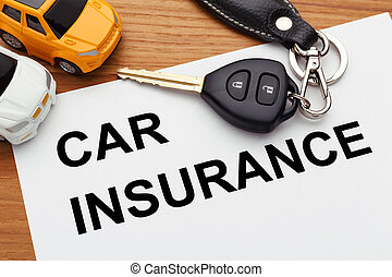 Car insurance concept with car key on wood table