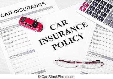 Car Insurance Policy. Document, Car, Glasses and Calculator on Table