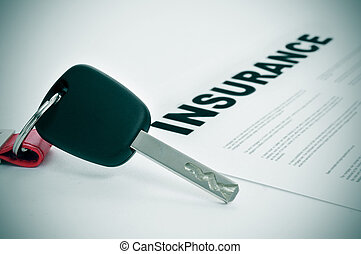 car insurance - closeup of a car key and a insurance policy...