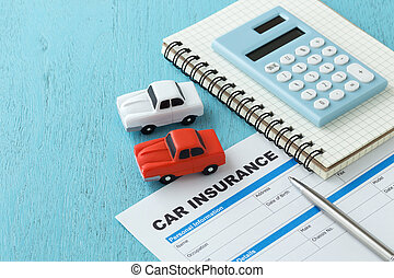 Car insurance with calculator on wooden background - Car...