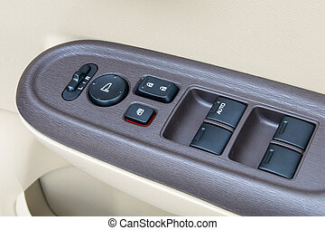 car interior details of door handle with windows controls and adjustments