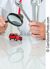 car is being examined by doctor - a model of a car is ...