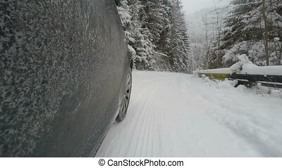 Car is driving on a winter road