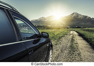 Car is driving on the country road.