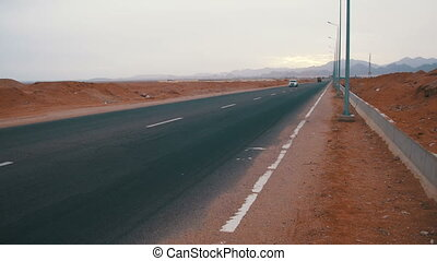 Car is Driving on the Desert Road
