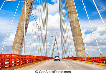 Car is moving through the beautiful bridge. The Francisco ...