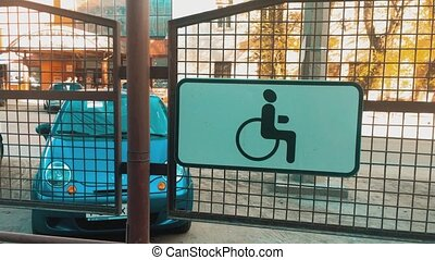 car is parked for disabled people. Parking place sign for...