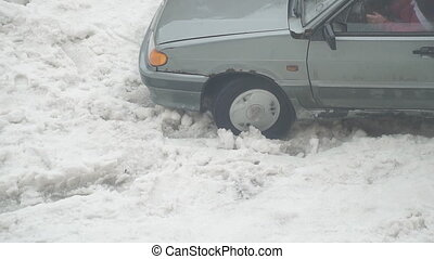 Car is stuck and slipping in the snow - The car is stuck and...