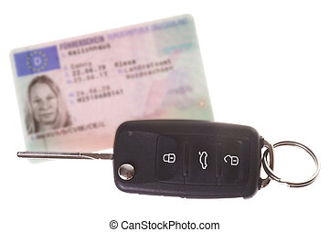 car Key - Car keys and driver license isolated over a white...