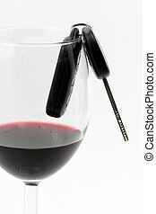 car key in a wine glass, concept of drunk driver