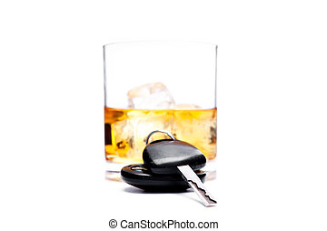 Car key in front of a glass of whiskey against a white...