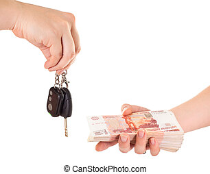 Car key in hand and cash money in other hand isolated ob white background