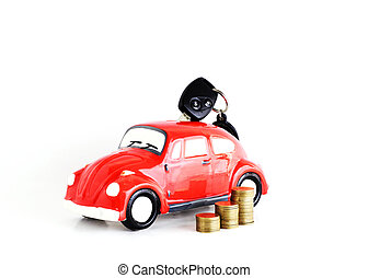 Car key into Car bank and coins stack on white background for loans concept