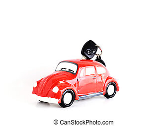 Car key into Car bank on white background for Car Loans concept