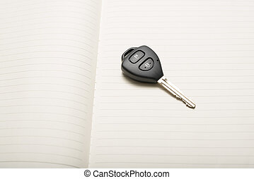 car key on notebook