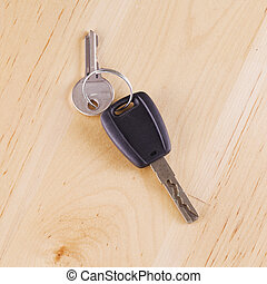 Car key over wooden table