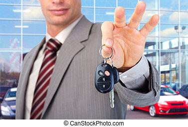 Car key. - Hand with a car key.
